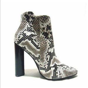 Snake skin heeled boots